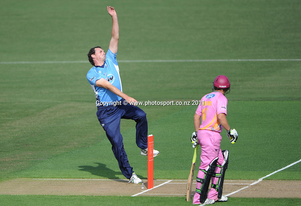 Kyle Mills bowling during the HRV Twenty20 Cricket match between the Auckland Aces and Northern Knights at Colin Maiden Oval in Auckland on Monday 26 December 2011. Photo: Andrew Cornaga/Photosport.co.nz