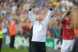 WIGAN, ENGLAND - Sunday, May 11, 2008: Manchester United's manager Alex Ferguson celebrates as his side beat Wigan Athletic 2-0 to win the Premier League for the 10th time during the final Premiership match of the season at the JJB Stadium. (Photo by David Rawcliffe/Propaganda)