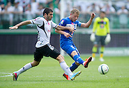 (R) Lech's Rafal Murawski fights for the ball with (L) Legia's Wladimer Dwaliszwili during T-Mobile Extraleague soccer match between Legia Warsaw and Lech Poznan at Pepsi Arena in Warsaw, Poland...Poland, Warsaw, May 18, 2013..Picture also available in RAW (NEF) or TIFF format on special request...For editorial use only. Any commercial or promotional use requires permission...Photo by © Adam Nurkiewicz / Mediasport