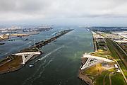 Nederland, Zuid-Holland, Nieuwe Waterweg, 22-05-2011; Maeslantkering in de Nieuwe Waterweg, gezien naar de Noordzee. Links het Calandkanaal  en de Maasvlakte, rechts aan de horizon Hoek van Holland. <br /> De stormvloedkering bestaat uit twee deuren die klaar liggen in een dok en welke sluiten bij een waterstand van 3 meter of meer boven NAP. De kering, laatst voltooide onderdeel van Deltawerken, beschermt Rotterdam en achterland bij extreme waterstanden.<br /> The new storm surge barrier (Maeslantkering) in the Nieuwe Waterweg (New Waterway, the entrance to the port of Rotterdam), North Sea at the horizon. <br /> In case of storm floods, the two enormous doors will close of the waterway protecting Rotterdam and its hinterland<br /> luchtfoto (toeslag); aerial photo (additional fee required)<br /> foto Siebe Swart / photo Siebe Swart
