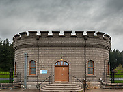 Gatehouse 5 at Reservoir 5 (completed 1911) under a stormy overcast sky, Mount Tabor Park, Portland, Oregon, USA.