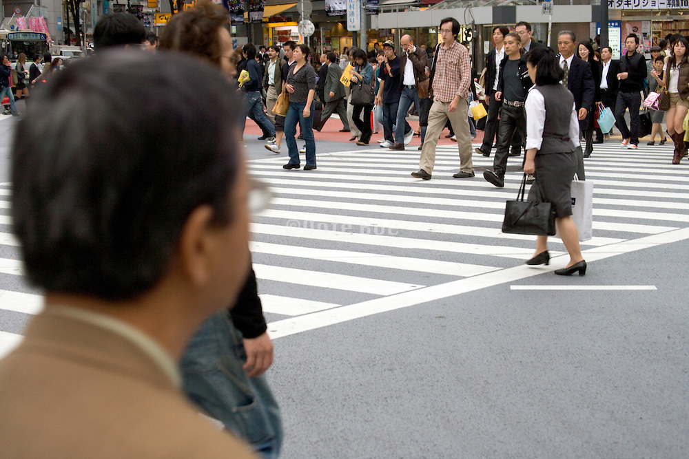 people crossing Hachiko intersection at Shibuya station