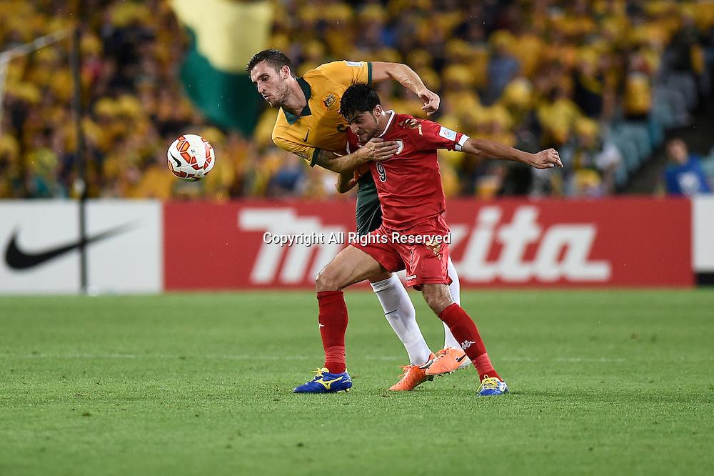 13.01.2015.  Sydney, Australia. AFC Asian Cup Group A. Australia versus Oman. Australian defender Matthew Spiranovic and Oman forward Abdulaziz Al-Muqbali. Australia won the game 4-0.