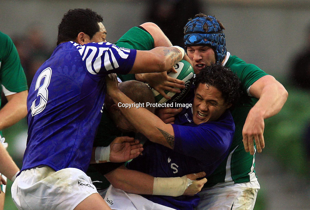 Guinness Autumn Series International, Aviva Stadium, Dublin 13/11/2010<br />Ireland vs Samoa<br />Ireland's Tom Court and Sean O'Brien tackle Tasesa Lavea of Samoa <br />Mandatory Credit &copy;INPHO/Dan Sheridan *** Local Caption ***