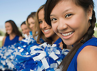Cheerleaders sitting on bench (portrait)