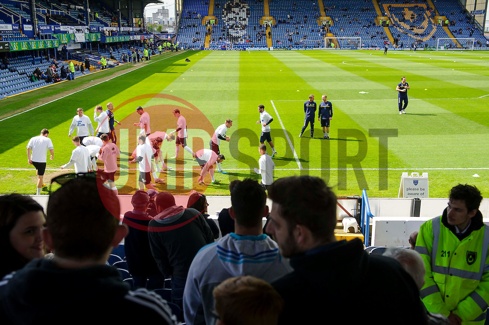 A general view from the away stand Bristol Rovers players warm up before the match - Photo mandatory by-line: Rogan Thomson/JMP - 07966 386802 - 19/04/2014 - SPORT - FOOTBALL - Fratton Park, Portsmouth - Portsmouth FC v Bristol Rovers - Sky Bet Football League 2.