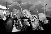 Three festival attendees pose for a picture while cooling off in a MTA bus at Artscape in Baltimore, MD on Saturday, July 20, 2013.
