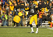 November 23 2013: Iowa Hawkeyes defensive back B.J. Lowery (19) celebrates after a play during the first quarter of the NCAA football game between the Michigan Wolverines and the Iowa Hawkeyes at Kinnick Stadium in Iowa City, Iowa on November 23, 2013. Iowa defeated Michigan 24-21.