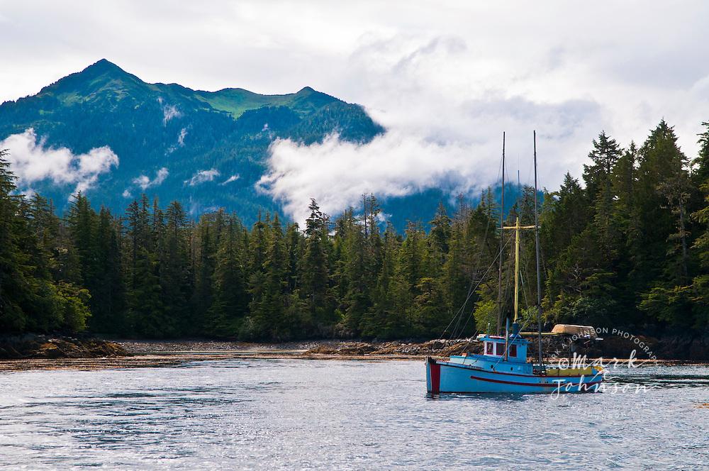 Salmon trolling fishing boat anchored off Baranof island, Alaska