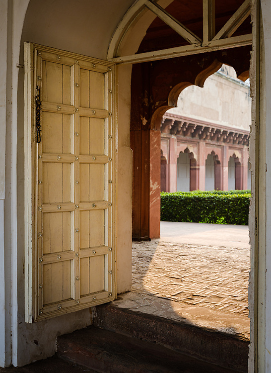 AGRA, INDIA - CIRCA NOVEMBER 2018: Doorway in Agra Fort. This is a historical fort in the city of Agra in India. It was the main residence of the emperors of the Mughal Dynasty until 1638, when the capital was shifted from Agra to Delhi. Agra is a city and very popular tourist destination on the banks of the Yamuna river in the Indian state of Uttar Pradesh.