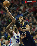 Dec 20, 2016; Philadelphia, PA, USA; New Orleans Pelicans forward Anthony Davis (23) shoots past Philadelphia 76ers center Joel Embiid (21) during the second quarter at Wells Fargo Center. Mandatory Credit: Bill Streicher-USA TODAY Sports
