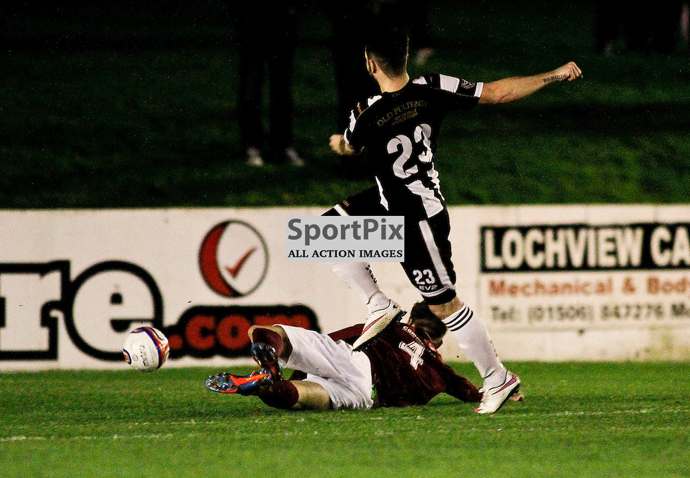 Sam Mackay scores from the edge of the box to give Wick an early lead in the William Hill Scottish cup tie at Prestonfield