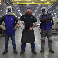 Welders in a locomotive factory in Texas