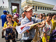 15 OCTOBER 2014 - BANGKOK, THAILAND: A souvenir vendor chases tourists on the sidewalk in front of the Grand Palace in Bangkok. The number of tourists arriving in Thailand in July fell 10.9 per cent from a year earlier, according to data from the Department of Tourism. The drop in arrivals is being blamed on continued uncertainty about Thailand's political situation. The tourist sector accounts for about 10 per cent of the Thai economy and suffered its biggest drop in visitors in June - the first full month after the army took power on May 22. Arrivals for the year to date are down 10.7% over the same period last year.   PHOTO BY JACK KURTZ