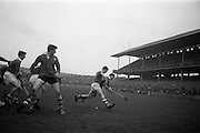 17/03/1965<br /> 03/17/1965<br /> 17 March 1965<br /> Railway Cup Hurling final  Munster v Leinster at Croke Park, Dublin. J. Bennett, Munster Right Full Forward (right) and S. Cleere, Leinster right half back race over the ball near the Leinster goalmouth.