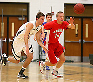 Linn-Mar's Matt Lassen (10) and Assumption's Matt Vonderhaar (15) battle for a lose ball during the 2013 Eastern Iowa All-Star Basketball Game at Iowa City West High School in Iowa City on Wednesday, March 27, 2013. The South (dark) defeated the North (white) 87-79.