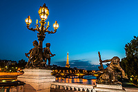 Pont Alexandre III Alexander the third bridge by night in the city of Paris in france