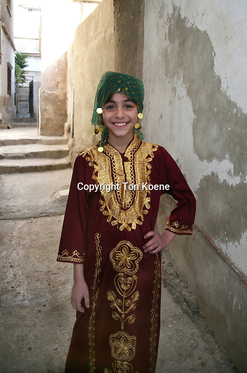 A young Iraqi girl in traditional dress