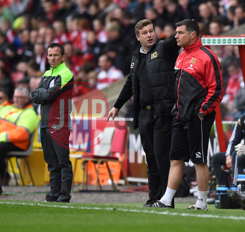Milton Keynes Dons Manager, Karl Robinson directs the fourth official Keith Stroud to the replay on the large screen - Photo mandatory by-line: Paul Knight/JMP - Mobile: 07966 386802 - 04/04/2015 - SPORT - Football - Swindon - The County Ground - Swindon Town v Milton Keynes Dons - Sky Bet League One