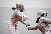 Concord-Carlisle's sabre fencer Julie Jacobs takes on Boston Latin's Annie Miall in their bout at the Concord-Carlisle Invitational Fencing Tournament, January 17, 2016. (Wicked Local Staff Photo/ Sam Goresh),