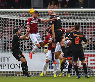 Picture by David Horn/Focus Images Ltd +44 7545 970036<br /> 16/11/2013<br /> Kane Ferdinand of Northampton Town (2nd left) goes close with a header during the Sky Bet League 2 match at Sixfields Stadium, Northampton.