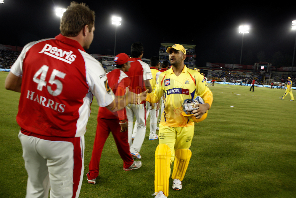 Chennai Super Kings captain Mahender Singh Dhoni meets players of Kings XI Punjab after match 9 of the Indian Premier League ( IPL ) Season 4 between the Kings XI Punjab and the Chennai Super Kings held at the PCA stadium in Mohali, Chandigarh, India on the 13th April 2011..Photo by Money Sharma/BCCI/SPORTZPICS