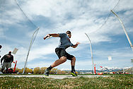 PRICE CHAMBERS / NEWS&amp;GUIDE<br /> Spencer Seeton winds up for his next throw during the discus event at the Lynn Williams Invitational track meet on Wednesday.