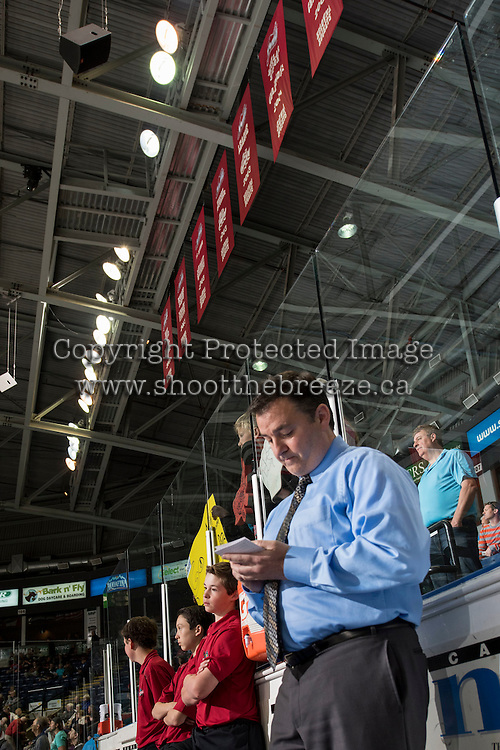 KELOWNA, CANADA - MAY 13: Dan Lambert, head coach of the Kelowna Rockets stands on the bench during warm up against the Brandon Wheat Kings on May 13, 2015 during game 4 of the WHL final series at Prospera Place in Kelowna, British Columbia, Canada.  (Photo by Marissa Baecker/Shoot the Breeze)  *** Local Caption *** Dan Lambert;