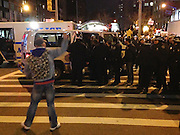 Dec. 4, 2014 - Manhattan, NY. A protestor gestures at police officers controlling a crowd demonstrating against the death of Eric Garner at 96th Street and Broadway. 12/4/14 Photograph by Jake Becker/NYCity Photo Wire