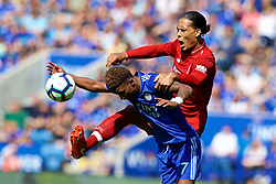LEICESTER, ENGLAND - Saturday, September 1, 2018: Liverpool's Virgil van Dijk and Leicester City's Demarai Gray during the FA Premier League match between Leicester City and Liverpool at the King Power Stadium. (Pic by David Rawcliffe/Propaganda)