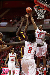 06 January 2016: Deontae Hawkins(23) bats the ball away from Donte Ingram(0) during the Illinois State Redbirds v Loyola-Chicago Ramblers at Redbird Arena in Normal Illinois (Photo by Alan Look)