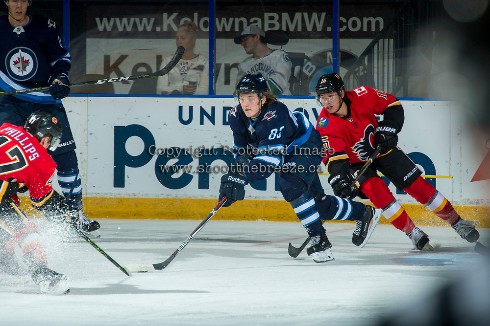 PENTICTON, CANADA - SEPTEMBER 11: Spencer Foo #15 of the Calgary Flames stick checks Sami Niku #83 of Winnipeg Jets on September 11, 2017 at the South Okanagan Event Centre in Penticton, British Columbia, Canada.  (Photo by Marissa Baecker/Shoot the Breeze)  *** Local Caption ***