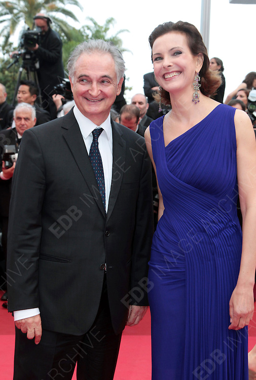 12.MAY.2011. CANNES<br /> <br /> CAROLE BOUQUET AND JACQUES ATTALI ARRIVING ON THE RED CARPET FOR THE SLEEPING BEAUTY PREMIERE AT THE 64TH CANNES INTERNATIONAL FILM FESTIVAL 2011 IN CANNES, FRANCE.<br /> <br /> BYLINE: EDBIMAGEARCHIVE.COM<br /> <br /> *THIS IMAGE IS STRICTLY FOR UK NEWSPAPERS AND MAGAZINES ONLY*<br /> *FOR WORLD WIDE SALES AND WEB USE PLEASE CONTACT EDBIMAGEARCHIVE - 0208 954 5968*