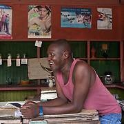 Every Cuban family registers with a local supply store, where they can use a libreta or ration book. The stores are just limited in quantity but also limited in the variety of items it has available.  Cubans manage their daily life whether waiting for in line, riding overcrowded busses or walking to their destination. <br /> Photography by Jose More