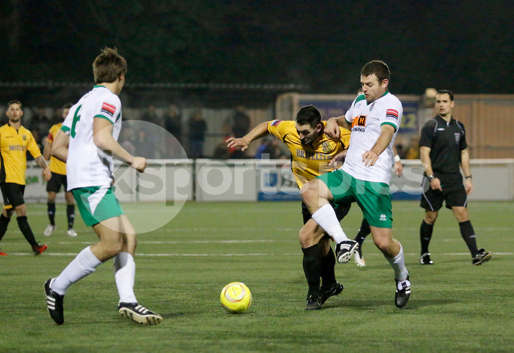 Dan Sackman of Bognor Regis Town gets the tackle in on Jay May of Maidstone Utd during the The Ryman Premier League match between Maidstone United and Bognor Regis Town at the Gallagher Stadium, London, England on 13 December 2014. Photo by Carlton  Myrie.