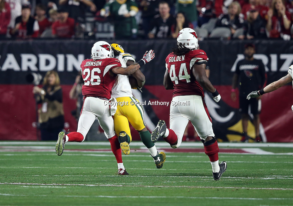 Green Bay Packers running back Eddie Lacy (27) is chased by Arizona Cardinals free safety Rashad Johnson (26) and Arizona Cardinals rookie outside linebacker Markus Golden (44) on a third quarter run of 61 yards good for a first and goal during the NFL NFC Divisional round playoff football game against the Arizona Cardinals on Saturday, Jan. 16, 2016 in Glendale, Ariz. The Cardinals won the game in overtime 26-20. (©Paul Anthony Spinelli)