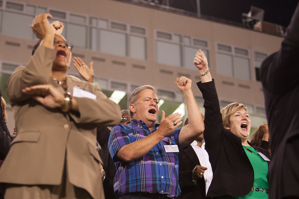 OUAA Athletics Reception attendees cheer for the Marching 110 at Peden Stadium on Thursday, October 8, 2015. Photo by Kaitlin Owens