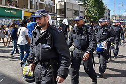 © Licensed to London News Pictures. 27/08/2017. London, UK. A strong and visible police presence is seen during Family Day at the Notting Hill Carnival.  Over one million revellers are expected to attend Europe's biggest street party which takes place over the Bank Holiday Weekend. Photo credit : Stephen Chung/LNP