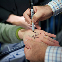 Republican Presidential candidate MITT ROMNEY signs autograph on a supporter's hand after holding a grassroots rally at Cherokee Trikes.  The South Carolina primary will be held on January 21st.