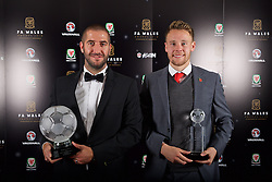 CARDIFF, WALES - Tuesday, November 8, 2016: Dafabet Welsh Premier League Clubman of the Year Award winner The New Saints' Phil Baker and Media Choice Award Winner Chris Gunter with their trophies during the FAW Awards Dinner at the Vale Resort. (Pic by David Rawcliffe/Propaganda)