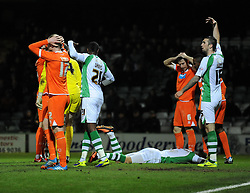 Yeovil Town's Shane Duffy and Yeovil Town's Liam Davis calls on for the paramedic  - Photo mandatory by-line: Joe Meredith/JMP - Tel: Mobile: 07966 386802 03/12/2013 - SPORT - Football - Yeovil - Huish Park - Yeovil Town v Blackpool - Sky Bet Championship