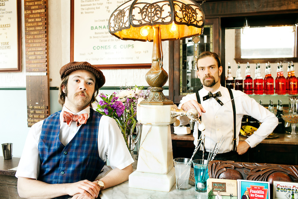 Brothers Eric (left) and Ryan Berley are co-owners of The Franklin Fountain in the historic Old City neighborhood of Philadelphia. They are pictured with the store's soda draft lamp, which was made about 1905, and restored by the brothers. Images from the Franklin Fountain ice cream and soda shop, which is located in the Old City neighborhood of Philadelphia, and run by the brothers Eric and Ryan Berley.