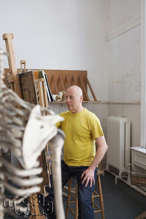 Artist drawing skeleton in studio