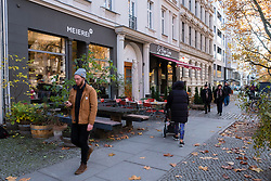 Street with cafes in gentrified district of Prenzlauer berg in Berlin Germany