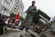 A soldier on a tank in the center of Tunis during a demonstration. The army is of good repute after he refuse to shoot the people during the early days of the crisis.
