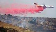 July 13, 2015 - Yorba Linda, CA, USA - <br /> <br /> water planes take to the sky to help put out fires<br /> <br /> An air tanker douses burning brush with fire retardant off the 241 toll road Monday near Irvine and Orange. More than 150 acres burned in unincorporated Orange County, <br /> ©Exclusivepix Media