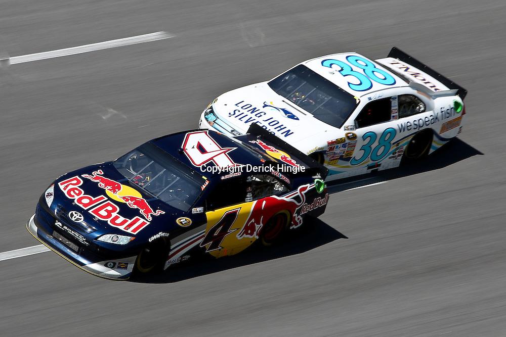 April 17, 2011; Talladega, AL, USA; NASCAR Sprint Cup Series driver Travis Kvapil (38) drafts Kasey Kahne (4) during the Aarons 499 at Talladega Superspeedway.   Mandatory Credit: Derick E. Hingle