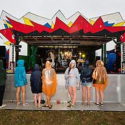 Dedicated fans watching Babeshadow in heavy rain at Farm Fest Bruton, Somerset.