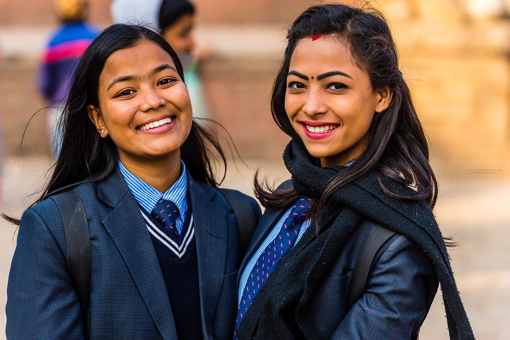 Nepalese girls in school uniform, Durbar Square, Bhaktapur, Kathmandu Valley, Nepal.