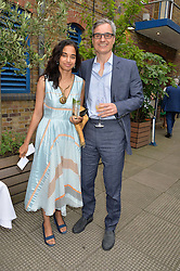 OLIVER HAARMANN and MALA GOANKAR at an Evening at The River Cafe in aid of the NSPCC held at The River Cafe, Thames Wharf, Rainville Road, London on 19th June 2016
